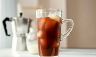 Mug of coffee with ice cubes