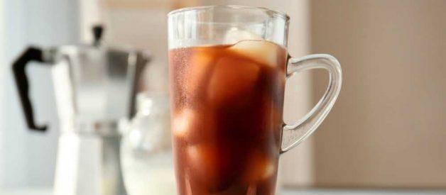 Mug of coffee with ice cubes