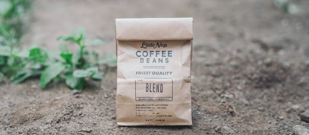 Photo of paper coffee bag on the ground